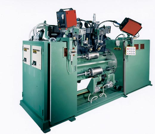 Lathe type welding machine equipped with dual weld heads with laser tracking